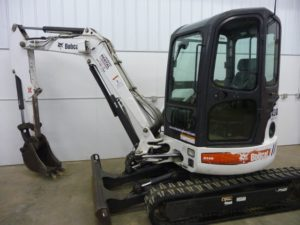 Maximum Dig Depth: 11 feet (132 inches) Operating Weight: 8,024 lbs Bucket Digging Force: 6,866 lbf Width: 70.1 in Height: 95.5 in Available Bucket Sizes: 13, 18 & 24 inch Cab with Heat & A/C Travel Speed High: 5 mph Travel Speed Low: 2.6 mph Click here for Specifications